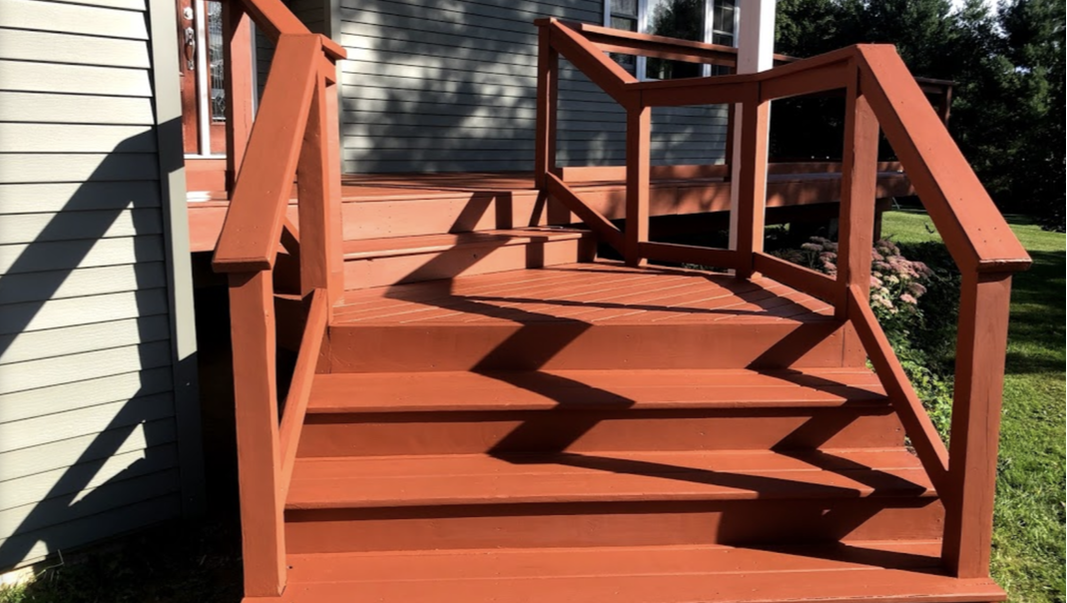 Newly painted and refinished stairs and deck