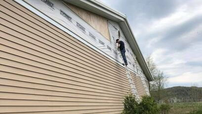 Siding repairs on exterior of retailer
